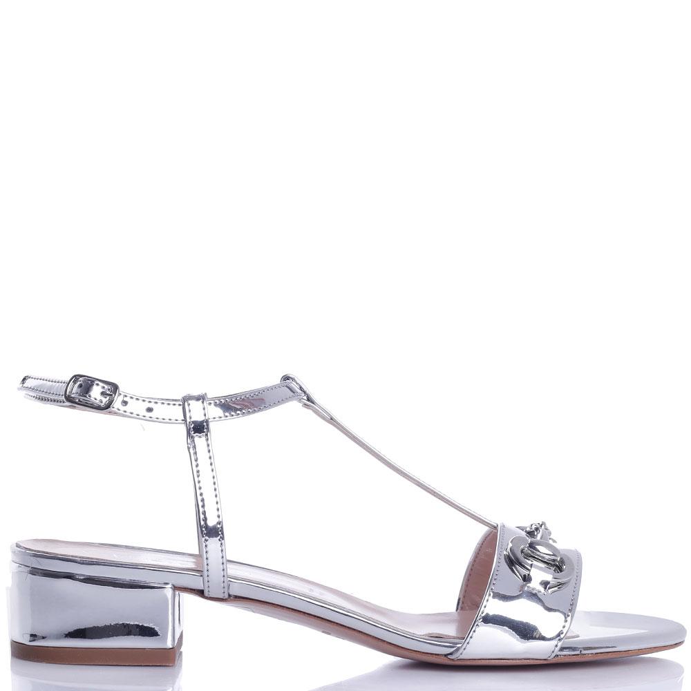 Босоножки Bianca Di серебристого цвета на низком каблуке