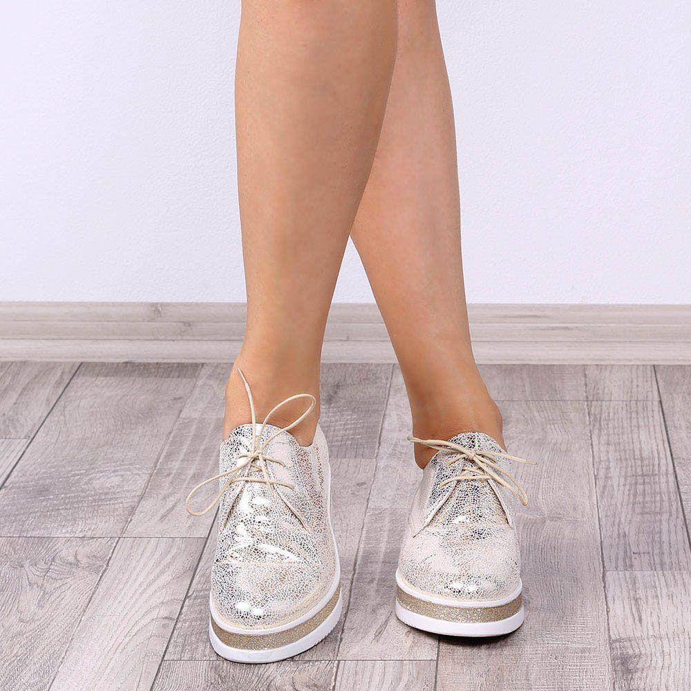 Слипоны со шнуровкой Ovye золотистого цвета на белой танкетке