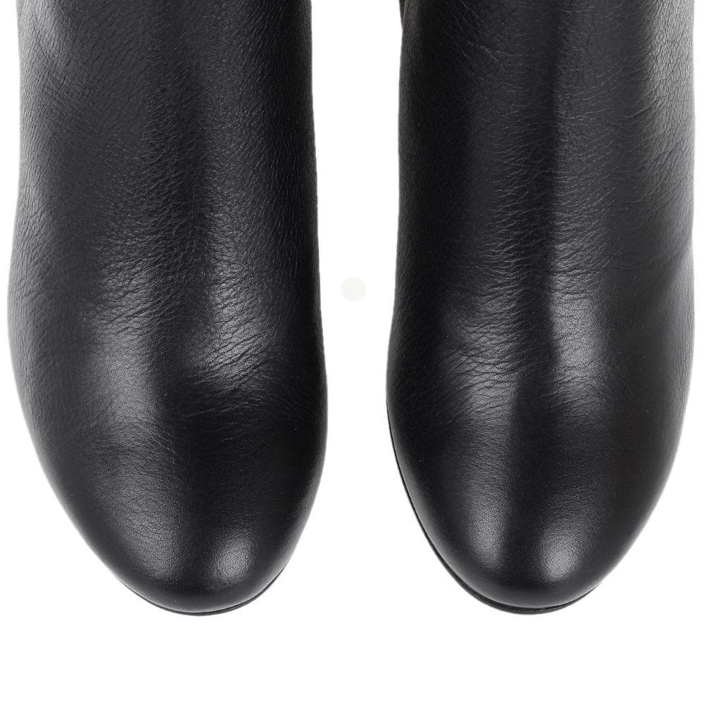 Кожаные зимние сапоги The Seller JD черного цвета на устойчивом каблуке