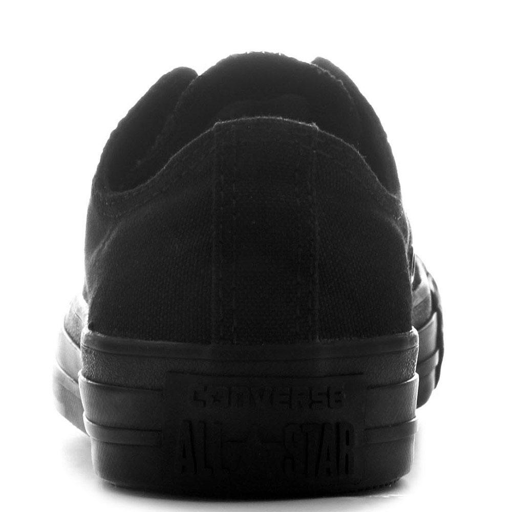 Низкие черные кеды Converse Chuck Taylor на черной подошве