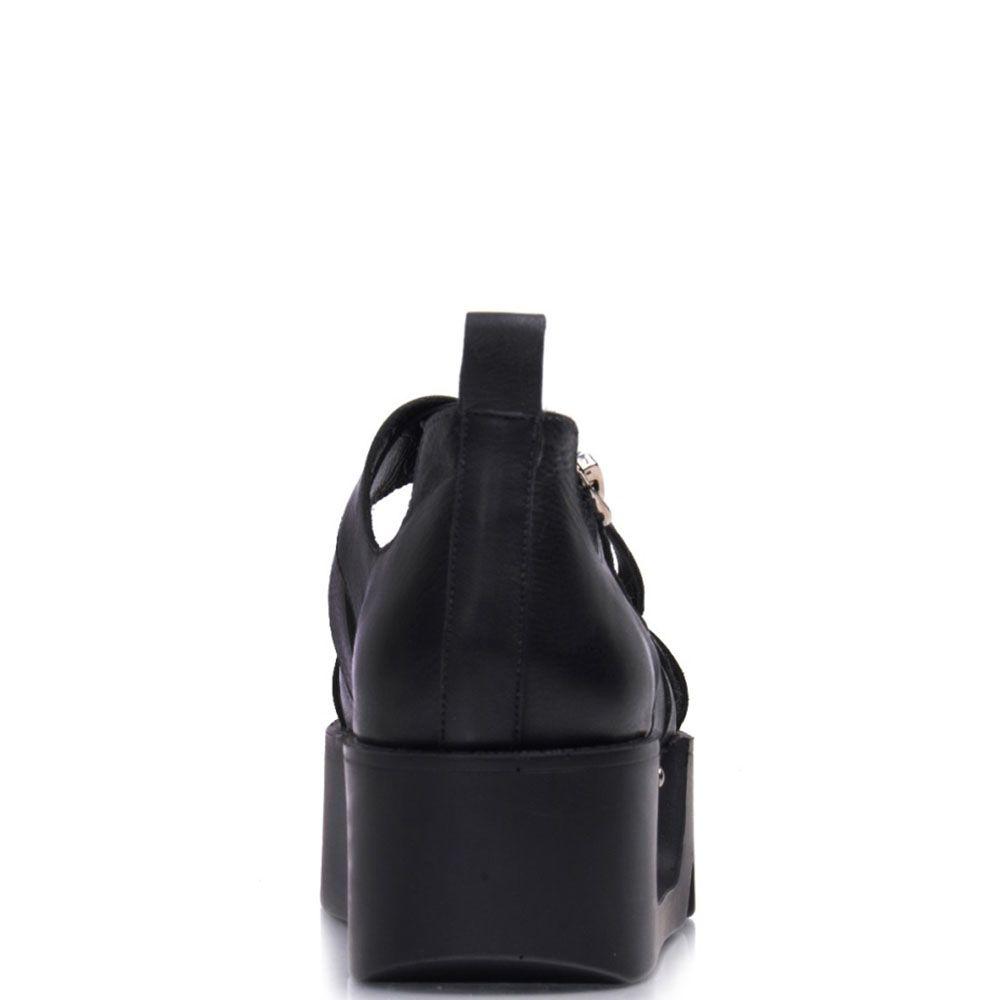 Сандалии Prego из кожи черного цвета на толстой рельефной подошве