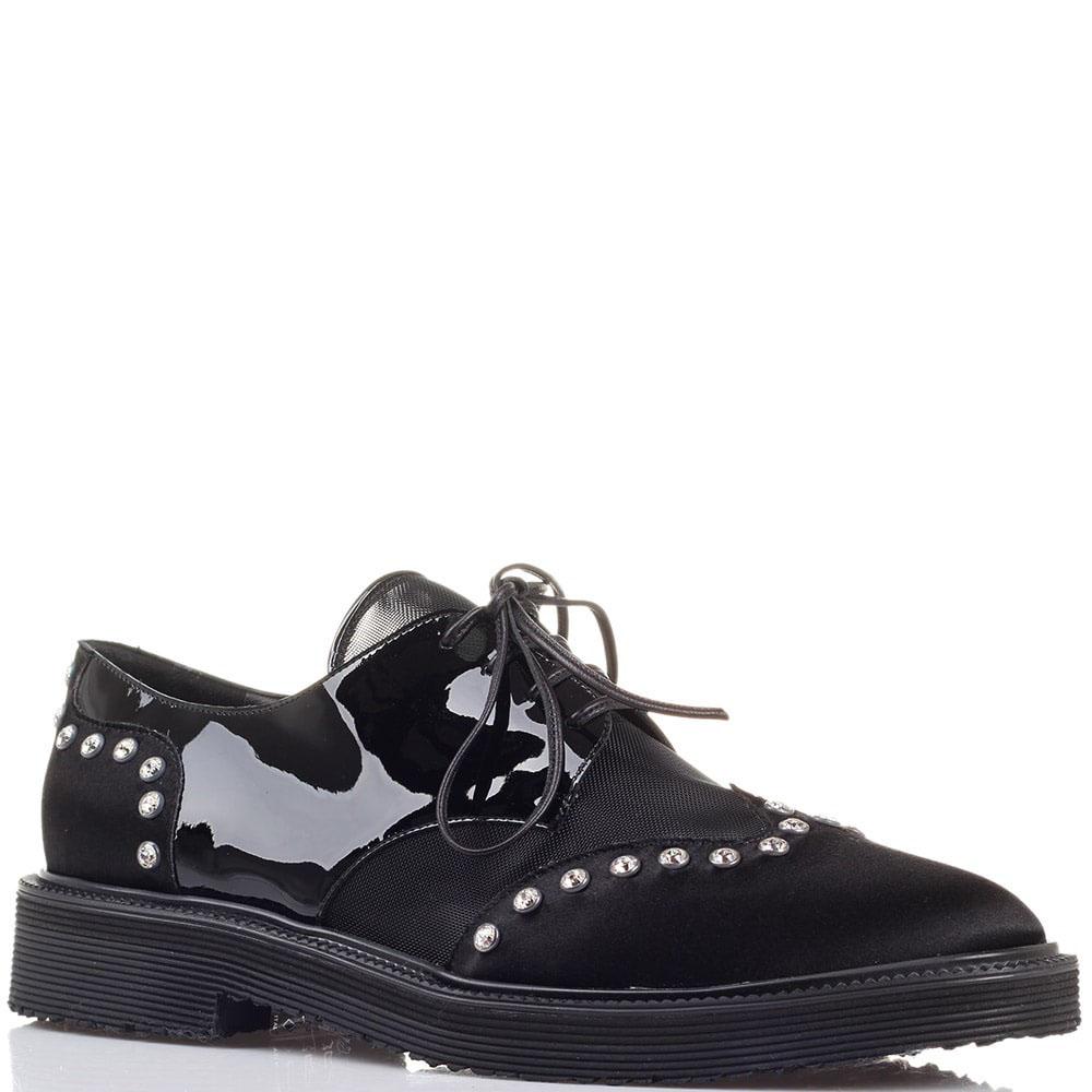 Черные туфли с лаковыми элементами Giuseppe Zanotti декорированные стразами