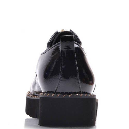 Туфли Prego черного цвета кожаные лаковые с толстой рельефной подошвой и золотистой молнией, фото