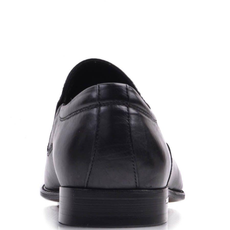 Лоферы Prego черного цвета из натуральной кожи с металлическим логотипом на каблуке