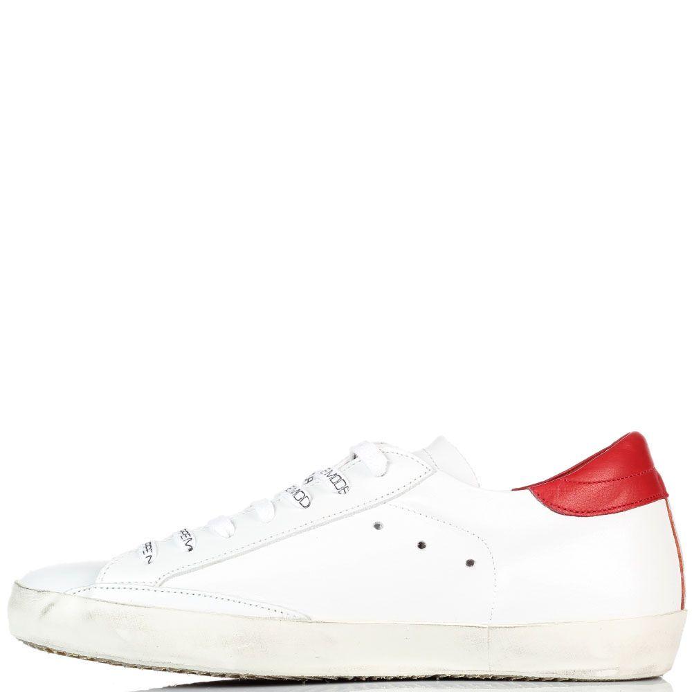 Белые кожаные кеды Philippe Model с фирменной нашивкой