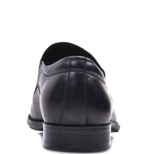 Туфли на резинках Prego черного цвета гладкие из натуральной кожи с круглым металлическим логотипом, фото