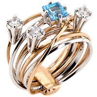 Широкое кольцо с топазом из комбинированного золота, фото