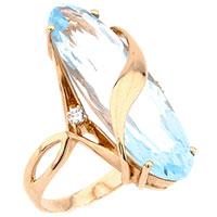 Золотое кольцо с крупным топазом овальной формы, фото