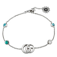 Серебряный браслет Gucci GG Marmont с цветочными деталями из серебра и камней, фото