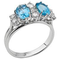 Золотое кольцо с бриллиантами и голубыми топазами, фото