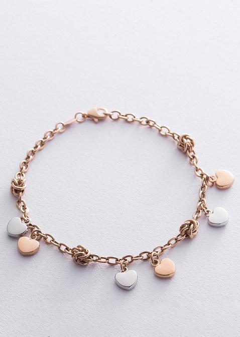 Золотой браслет с подвесками в форме сердец, фото