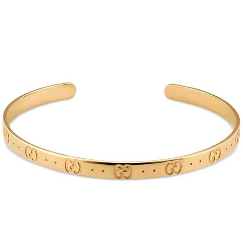 Тонкий незамкнутый браслет Gucci Icon из желтого полированного золота с тиснением, фото