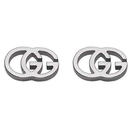 Серьги-гвоздики Gucci Running G из белого золота в форме двух сплетенных букв G, фото