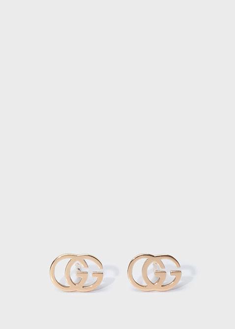 Серьги-гвоздики Gucci Running G из розового золота в форме двух сплетенных букв G, фото