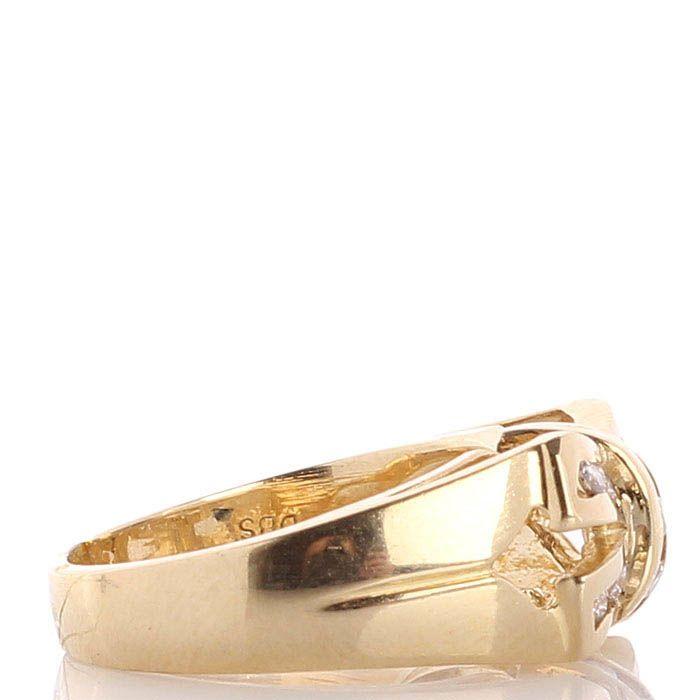 Широкое кольцо из желтого золота инкрустированное бриллиантами в виде банта