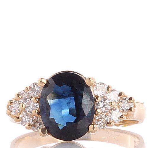 Перстень из желтого золота с крупным сапфиром и бриллиантами