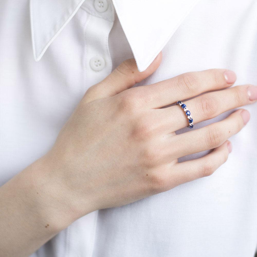 Кольцо из золота Оникс с бриллиантами и сапфирами