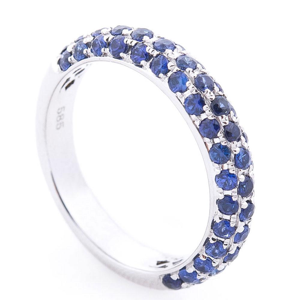 Золотое кольцо Оникс с синими сапфирами