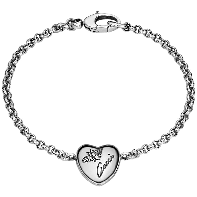 Тонкий серебряный браслет Gucci Flora с подвеской в форме сердца и гравировкой