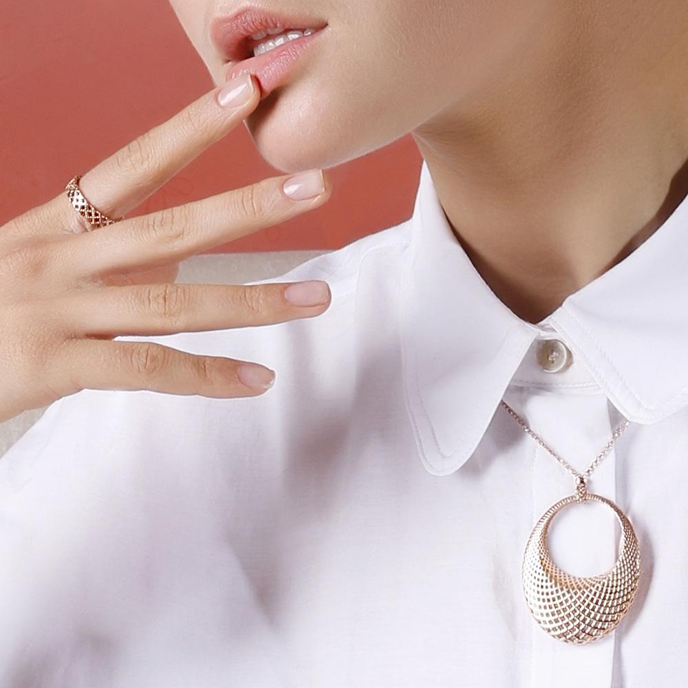 Широкое кольцо Gucci Diamantissima из розового золота с перфорированным узором