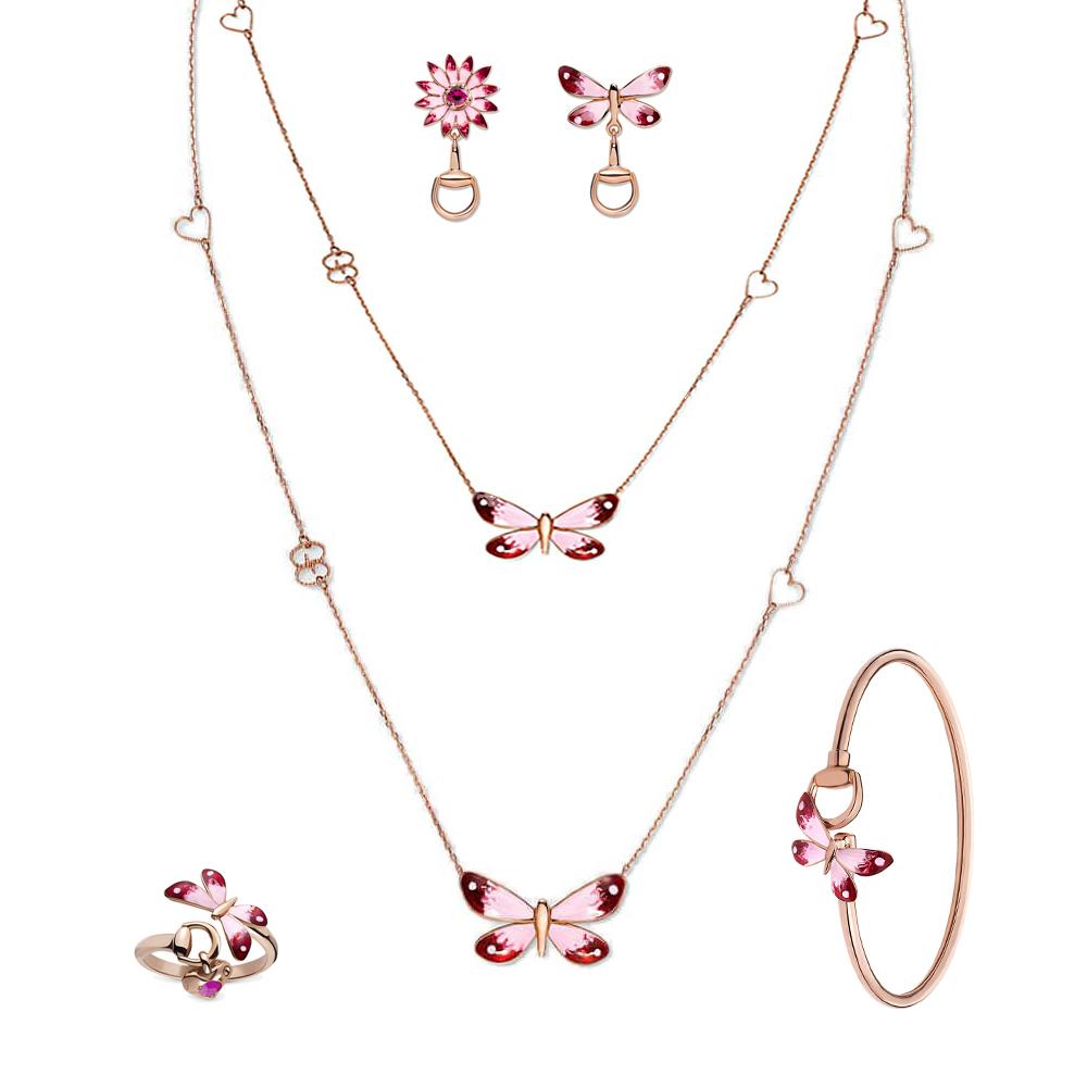 Серьги-гвоздики Gucci Flora из розового золота с рубином в форме цветка и бабочки