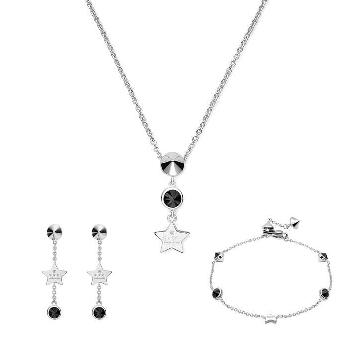 Серьги-подвески Gucci Trademark на застежках-гвоздиках с черными камнями и подвесками-звездами