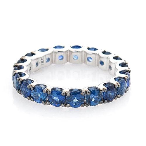 Золотое кольцо Оникс с синими сапфирами, фото