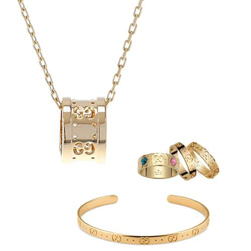 Золотое кольцо Gucci Icon с отчеканенной поверхностью и фирменным тиснением, фото
