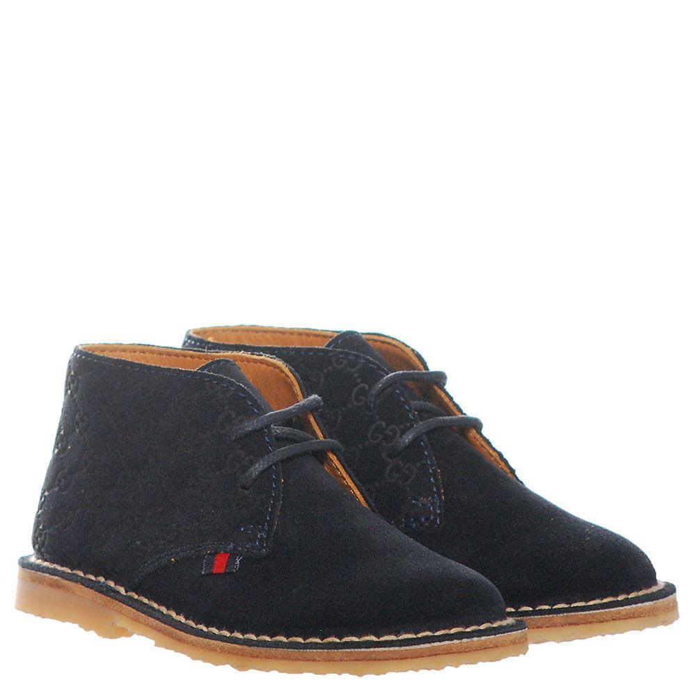 Замшевые ботинки синего цвета Gucci с фирменным тиснением