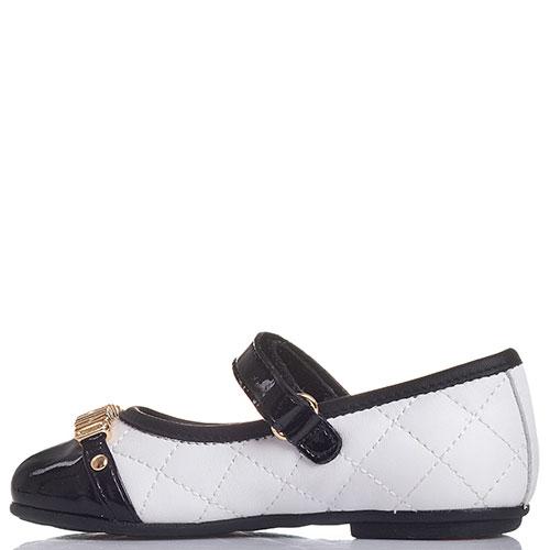 Черно-белые туфли Moschino с лаковыми ремешком и носочком, фото