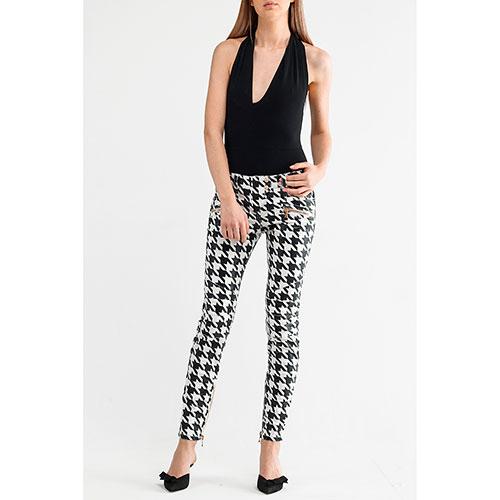 Черно-белые брюки Balmain с принтом-звездами, фото