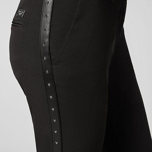 Черные брюки Philipp Plein с заклепками в форме звезд, фото