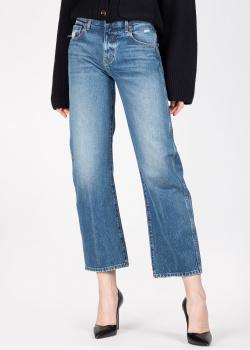 Расклешенные джинсы Khaite с потертостями на карманах, фото