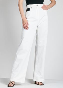 Расклешенные джинсы Paco Rabanne с черными карманами, фото