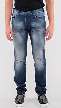 Рваные джинсы Emporio Armani с потертостями, фото