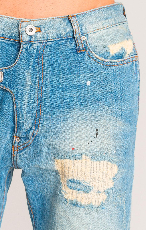 Голубые джинсы Emporio Armani с эффектом брызг краски