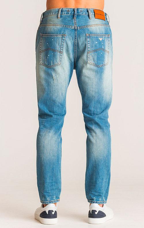 Голубые джинсы Emporio Armani с эффектом брызг краски, фото