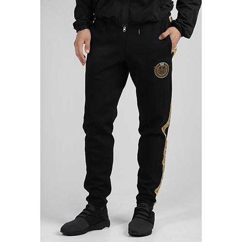 Спортивные брюки Ea7 Emporio Armani с золотистыми лампасами, фото