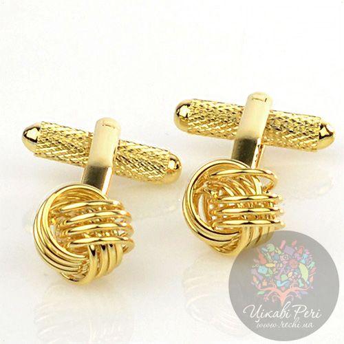 Запонки Интересные запонки в виде золотых узелков, фото