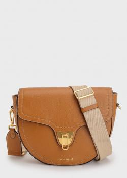 Кожаная сумка Coccinelle на широком ремне, фото