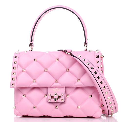 Маленькая розовая сумка Valentino Garavani с декором-заклепками, фото