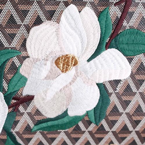 Сумка из кожи сафьяно Lancaster коричневого цвета с флористической вышивкой и геометрическим принтом, фото