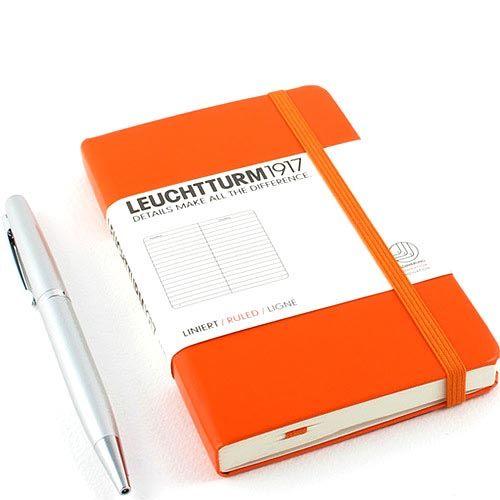 Карманная записная книжка Leuchtturm1917 оранжевого цвета в клетку, фото