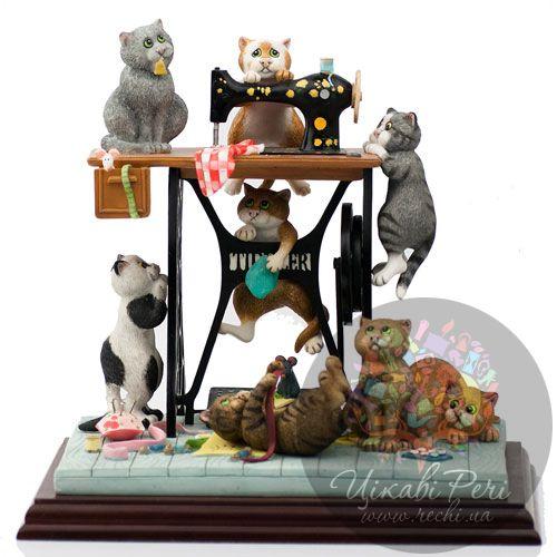 Коты в ателье Enesco, фото