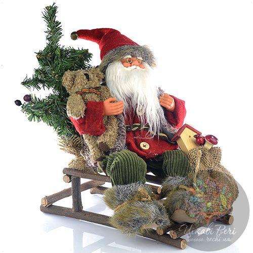 Санта Wurm KG на санях с подарками и елкой, фото