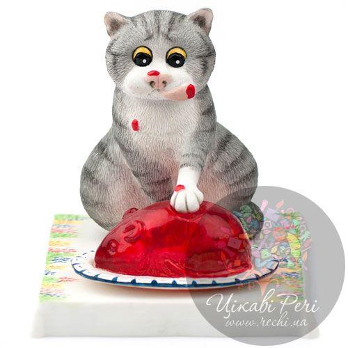 Кот ест вкусное желе Enesco