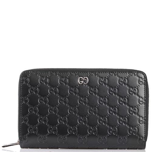 Кошелек Gucci из черной кожи с тиснением, фото