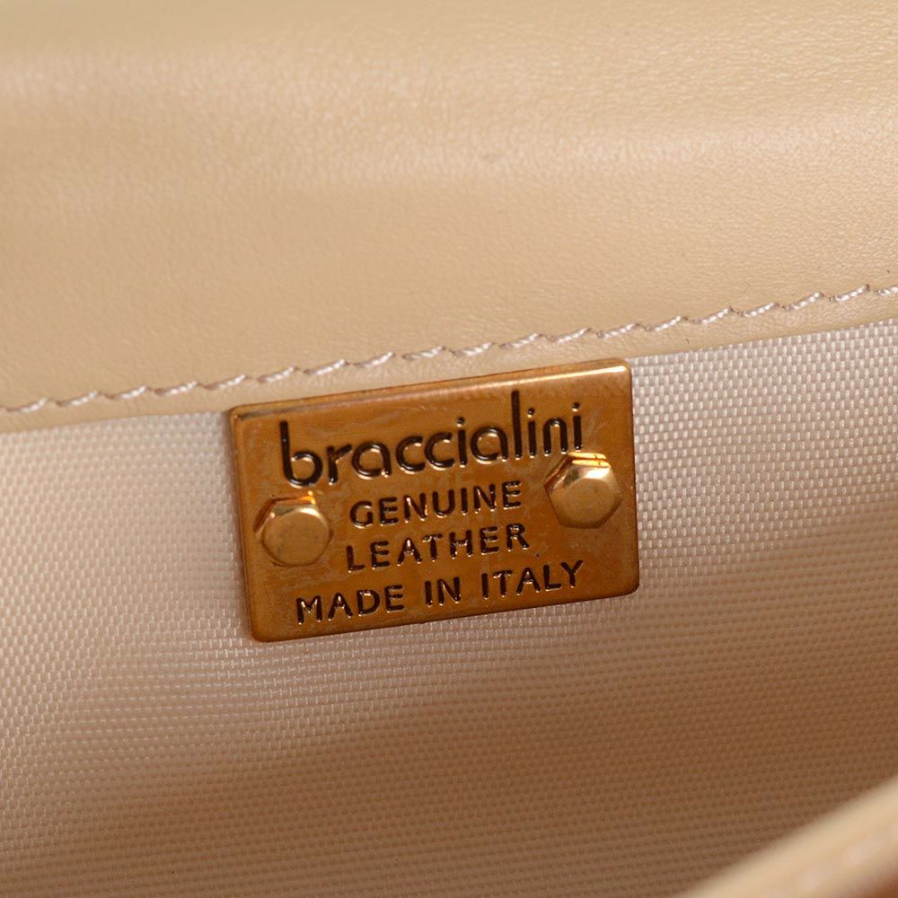 Портмоне Braccialini коричневого цвета с перфорацией в виде цветов