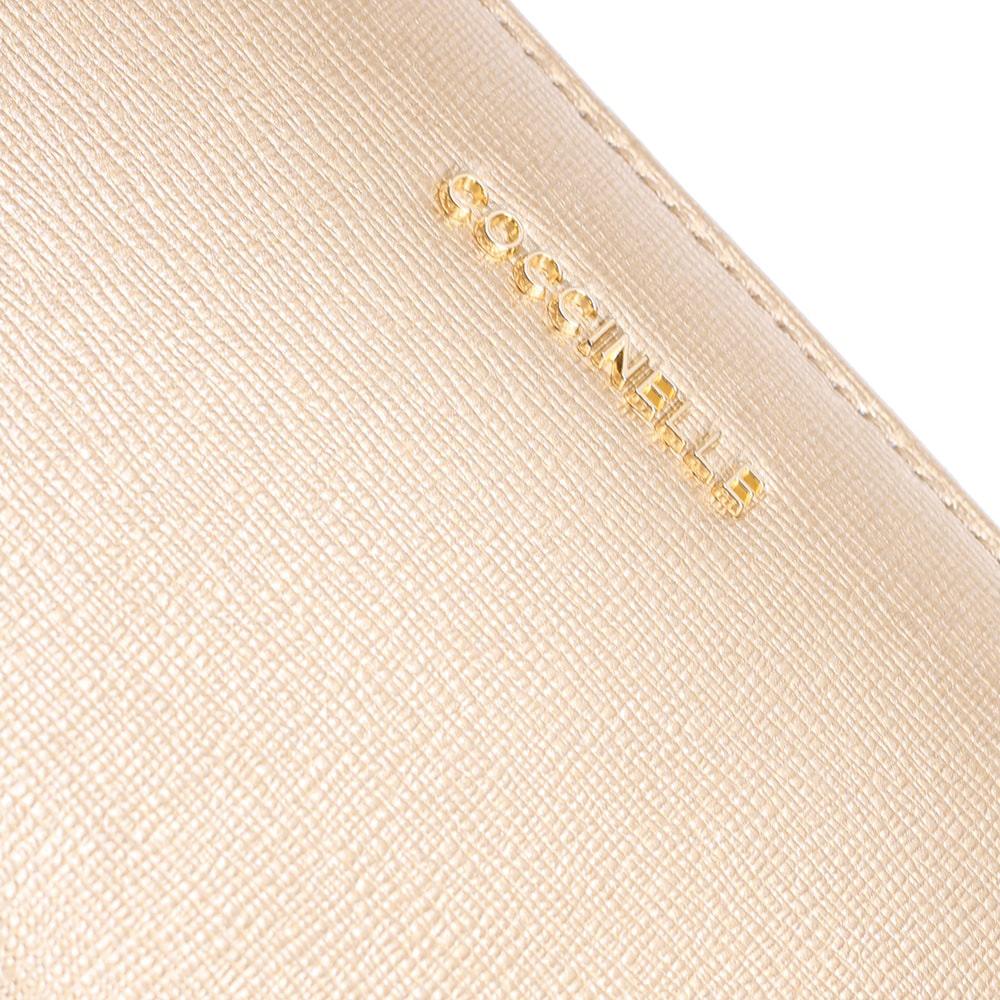 Золотистое портмоне Coccinelle из кожи с тиснением Сафьяно
