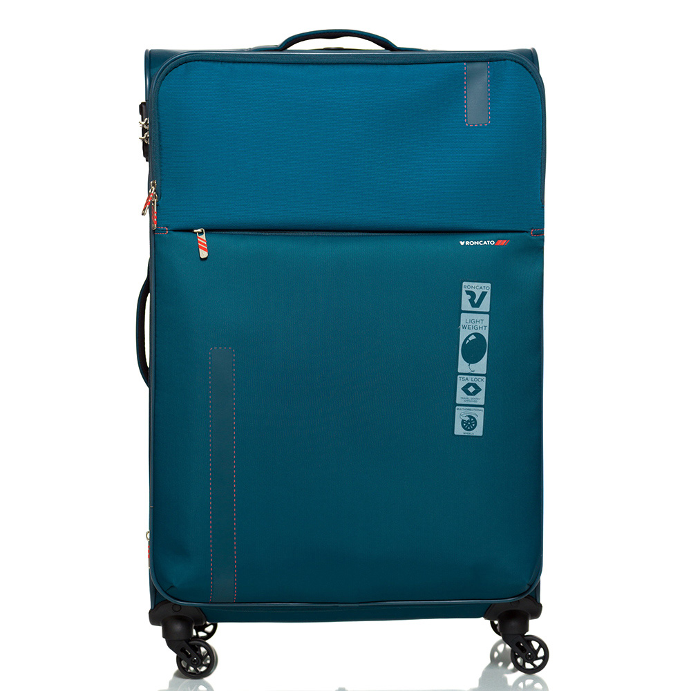 Большой дорожный чемодан 78х48х29-32см Roncato Speed синего цвета 4-х колесный